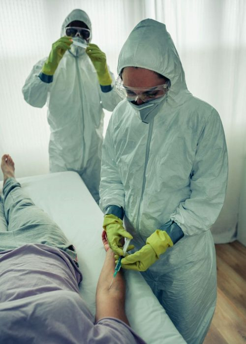 doctors-injecting-a-vaccine-to-a-patient-AKNCBBF.jpg